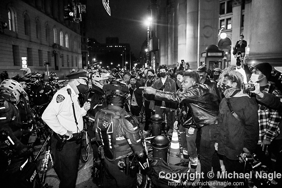 NEW YORK, NY — OCTOBER 27, 2020:  The NYPD and demonstrators clash during a protest gainst police brutality, in response to the shooting of Walter Wallace Jr. by Philadelphia police officers the prior day, across from City Hall on October 27, 2020 in New York City.  The confrontation, recorded on a now viral video posted to social media, shows Wallace, a 27 year-old Black man who family members said was in the midst of a mental health crisis, holding a knife as two police officers shot and killed him.  Photograph by Michael Nagle