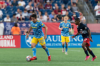 FOXBOROUGH, MA - AUGUST 8: Ilsinho #25 of Philadelphia Union brings the ball forward during a game between Philadelphia Union and New England Revolution at Gillette Stadium on August 8, 2021 in Foxborough, Massachusetts.