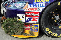Feb 21, 2009; Fontana, CA, USA; Detailed view of the front end of the car driven by NASCAR Sprint Cup Series driver Reed Sorenson after crashing during practice for the Auto Club 500 at Auto Club Speedway. Mandatory Credit: Mark J. Rebilas-