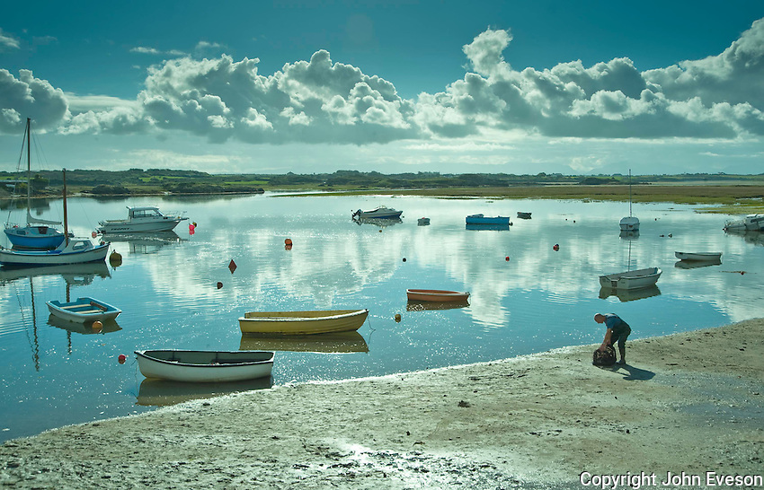 Fisherman with a lobster pot, Four Mile Bridge, Holy Island, Anglesey....Copyright..John Eveson, Dinkling Green Farm, Whitewell, Clitheroe, Lancashire. BB7 3BN.01995 61280. 07973 482705.j.r.eveson@btinternet.com.www.johneveson.com