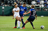 TACOMA, WA - JULY 31: Ebony Salmon #9 of Racing Louisville FC and Alana Cook #4 of the OL Reign battle for the ball during a game between Racing Louisville FC and OL Reign at Cheney Stadium on July 31, 2021 in Tacoma, Washington.