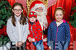 Caoimhe and Dylan O'Connell and Millie Hughes from Scartaglin enjoying meeting Santa Claus in the Manor West Shopping Centre on Saturday.