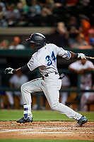 Tampa Tarpons center fielder Estevan Florial (34) follows through on a swing during a game against the Lakeland Flying Tigers on April 5, 2018 at Publix Field at Joker Marchant Stadium in Lakeland, Florida.  Tampa defeated Lakeland 4-2.  (Mike Janes/Four Seam Images)