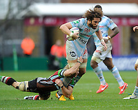 Camille Gerondeau of Racing Metro 92 is tackled by Matt Hopper of Harlequins during the Heineken Cup match between Harlequins and Racing Metro 92 at the Twickenham Stoop on Sunday 15th December 2013 (Photo by Rob Munro)