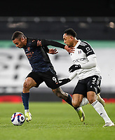 13th March 2021, Craven Cottage, London, England;  Manchester Citys Gabriel Jesus challenges Fulhams Kenny Tete during the English Premier League match between Fulham and Manchester City at Craven Cottage in London
