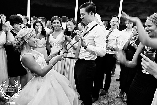 A wedding couple dances with adoring friends at the American Yacht Club Wedding.