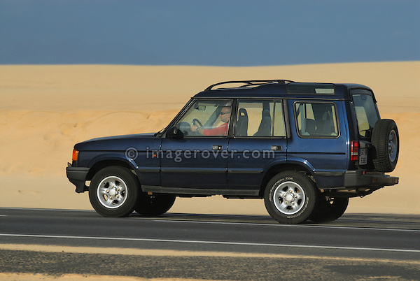 Spain, Canary Islands, Fuerteventura, nr. Corralejo. Parque Natural de los Dunas de Corralejo. Land Rover Discovery 1. --- No releases available. Automotive trademarks are the property of the trademark holder, authorization may be needed for some uses.