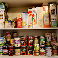 The inside of the food cupboard of Robert Wagstaff, 48, a foodbank user from Paisley in Glasgow.