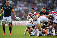 Fumiaki Tanaka of Japan passes the ball out. Rugby World Cup Pool B match between South Africa and Japan on September 19, 2015 at the Brighton Community Stadium in Brighton, England. Photo by: Patrick Khachfe / Stewart Communications