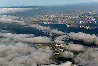 aerial photograph Treasure Island San Francisco partially covered in fog with view toward Oakland