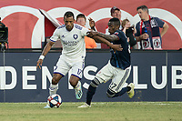 FOXBOROUGH, MA - JULY 27:  Luis Caicedo #27 tackles Nani #17 at Gillette Stadium on July 27, 2019 in Foxborough, Massachusetts.