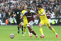 Said Benrahma of West Ham tries to outpace Brentford's Christian Norgaard during West Ham United vs Brentford, Premier League Football at The London Stadium on 3rd October 2021