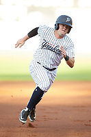 Cody Brown (2) of the Pulaski Yankees hustles towards third base against the Greeneville Reds at Calfee Park on June 23, 2018 in Pulaski, Virginia. The Reds defeated the Yankees 6-5.  (Brian Westerholt/Four Seam Images)