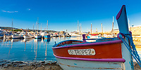Wooden old fishing boat named Saint-Tropez, in StTropez harbor, Azure Coast France