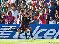 PASADENA, CA – June 25, 2011: Mexico players Andres Guardado (18) and Javier Hernandez (14) celebrate a goal during the Gold Cup Final match between USA and Mexico at the Rose Bowl in Pasadena, California. Final score USA 2 and Mexico 4.