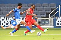 KANSAS CITY, KS - JULY 15: Cyle Larin #17 of Canada crosses the ball during a game between Canada and Haiti at Children's Mercy Park on July 15, 2021 in Kansas City, Kansas.