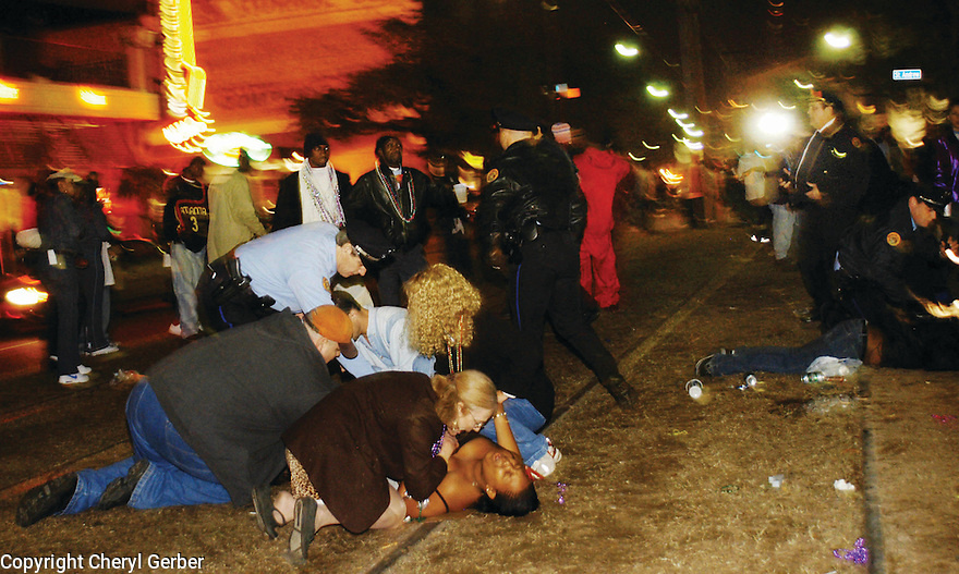 Parade-goers tend to two women shot during the Muses parade on St. Charles Avenue, 2004