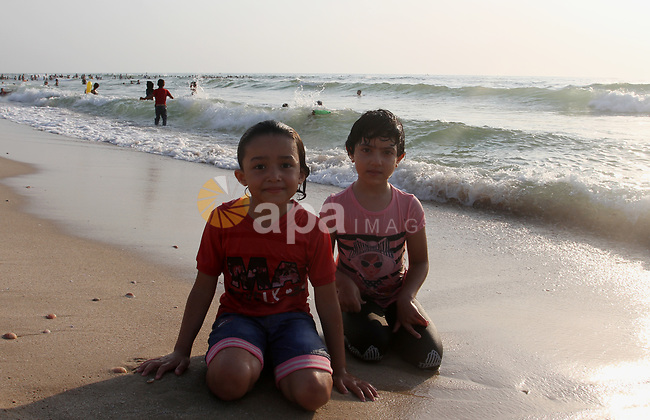 Palestinians enjoy the beach of the Mediterranean sea in Gaza City, on August 6, 2021. The beach is one of the few open public spaces in this densely populated city. Photo by Omar Ashtawy