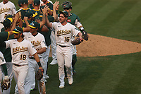 OAKLAND, CA - OCTOBER 1:  Liam Hendriks #16 of the Oakland Athletics celebrates with his teammates after the last out against the Chicago Sox to win Wild Card Round Game Three and the payoff series at the Oakland Coliseum on Thursday, October 1, 2020 in Oakland, California. (Photo by Brad Mangin)