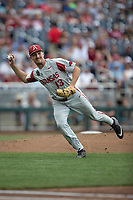 Arkansas Razorbacks pitcher Connor Noland (13) makes a throw to first base during Game 5 of the NCAA College World Series against the Texas Tech Red Raiders on June 17, 2019 at TD Ameritrade Park in Omaha, Nebraska. Texas Tech defeated Arkansas 5-4. (Andrew Woolley/Four Seam Images)