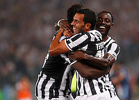 Calcio, Supercoppa di Lega: Juventus vs Lazio. Roma, stadio Olimpico, 18 agosto 2013<br /> Juventus forward Carlos Tevez, of Argentina, center, celebrates with teammates Paul Pogba, left, and Kwadwo Asamoah during the Italian League Supercup football final match between Juventus and Lazio, at Rome's Olympic stadium,  18 August 2013.<br /> UPDATE IMAGES PRESS/Riccardo De Luca