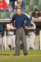 Home plate umpire Koyu Inoue between innings of the South Atlantic League game between the Asheville Tourists and the Kannapolis Intimidators at Fieldcrest Cannon Stadium April 11, 2009 in Kannapolis, North Carolina. (Photo by Brian Westerholt / Four Seam Images)