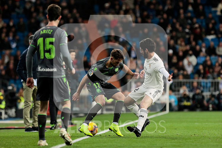 Real Madrid's Francisco Alarcon 'Isco' and Real Sociedad's Aritz Elustondo (L) and Adnan Januzaj (R) during La Liga match between Real Madrid and Real Sociedad at Santiago Bernabeu Stadium in Madrid, Spain. January 06, 2019. (ALTERPHOTOS/A. Perez Meca)<br />  (ALTERPHOTOS/A. Perez Meca)