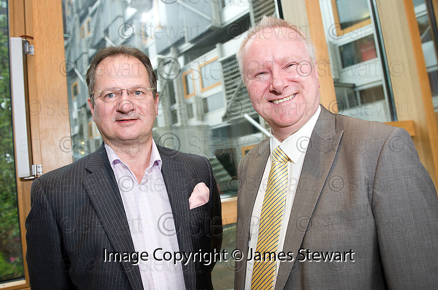 Cabinet Secretary for Infrastructure and Capital Investment, Alex Neil MSP (right),  with Graeme Ross, Business Development Director, BMI Regional, at the announcement of the sale of BMI Regional's sale from IAG to Sector Aviation  Holdings (SAH) .............31/05/2012    jsp004_bmi   .Copyright  Pic : James Stewart.James Stewart Photography 19 Carronlea Drive, Falkirk. FK2 8DN      Vat Reg No. 607 6932 25.Telephone      : +44 (0)1324 570291 .Mobile              : +44 (0)7721 416997.E-mail  :  jim@jspa.co.uk.If you require further information then contact Jim Stewart on any of the numbers above........