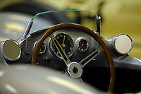 Detail: steering wheel and dash..#16 1954 Mercedes-Benz W 196      This unique, streamlined full-bodied model of car won the Formula One Constructors Championship in 1954 and 1955 in the hands of drivers Juan Manuel Fangio, Karl Kling, Stirling Moss and Hans Herrmann.
