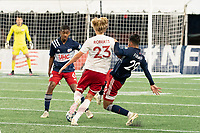 FOXBOROUGH, MA - OCTOBER 16: Nicolas Firmino #29 of New England Revolution II slides to tackle Thomas Roberts #23 of North Texas SC during a game between North Texas SC and New England Revolution II at Gillette Stadium on October 16, 2020 in Foxborough, Massachusetts.