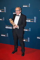 """French cinematographer Pascal Marti poses with the trophy during a photocall after winning the Best Photo award for """"Frantz"""" during the 42nd edition of the Cesar Ceremony at the Salle Pleyel in Paris on February 24, 2017."""