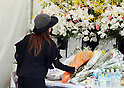 Animation fans offer prayers for the victims in the arson attack at the Kyoto Animation studio