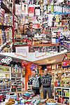 DI TUTTO DI PIU'<br /> Lo spaccio di Hamid Louni<br /> La cartoleria Peter Pan<br /> <br /> Sperso tra le merci<br /> serio l'uomo sta a controllare<br /> a riempire gli angoli,<br /> a stipare.<br /> Sembra il negozio dei cartolai<br /> dove di tutto<br /> - più giocattoli meno quaderni-<br /> puoi trovare.<br /> <br /> Più giocattoli<br /> meno quaderni<br /> più tigri<br /> meno penne,<br /> scaffali riempiti con garbo<br /> e le luci lassù, in disparte, senza disturbare.<br /> C'è chi sorride e chi no,<br /> chi s'appoggia avanti chi indietro<br /> ma bene s'incastrano i due cartolai:<br /> viola le righe e la maglietta<br /> grigio nero bianco mescolati<br /> coriandoli di vita diventati.