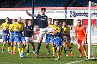 3rd April 2021; Dens Park, Dundee, Scotland; Scottish FA Cup Football, Dundee FC versus St Johnstone; Shaun Byrne of Dundee challenges for the ball with ChrisKane of St Johnstone