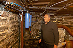 WOODBURY, CT. 28 December 2018-122818 - Arnaud Bourgeois looks at his filters set-up downstairs at his home in Woodbury on Friday. Arnaud has questioned the water company as to why his water looks so dirty. Bill Shettle Republican-American