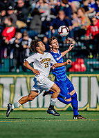 26 October 2019: University of Vermont Catamount Forward JoJo Moulton-Condiotti, a Freshman from Brooklyn, NY, chases down UMass Lowell River Hawk Backfielder Denis Petro, a Freshman from Michalovce, Slovakia, in the first half of NCAA Soccer play at Virtue Field in Burlington, Vermont. The Catamounts rallied to defeat the River Hawks 2-1, propelling the Cats to the America East Division 1 conference playoffs. Mandatory Credit: Ed Wolfstein Photo *** RAW (NEF) Image File Available ***