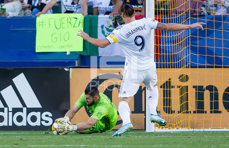CARSON, CA - SEPTEMBER 29: GK Maxime Crepeau #16 of the Vancouver Whitecaps makes a save during a game between Vancouver Whitecaps and Los Angeles Galaxy at Dignity Health Sports Park on September 29, 2019 in Carson, California.