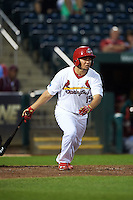 Springfield Cardinals outfielder Breyvic Valera (15) at bat during a game against the Frisco RoughRiders  on June 3, 2015 at Hammons Field in Springfield, Missouri.  Springfield defeated Frisco 7-2.  (Mike Janes/Four Seam Images)
