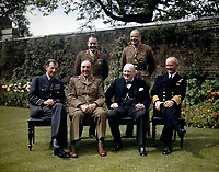 The Prime Minister, the Rt Hon Winston Churchill, With His Chiefs of Staff in the Garden of No 10 Downing Street, London, 7 May 1945 Seated, left to right: Air Chief Marshal Sir Charles Portal; Field Marshal Sir Alan Brooke, the Rt Hon Winston Churchill; Admiral Sir Andrew Cunningham. Standing, left to right: the Secretary to the Chiefs of Staffs Committee, Major General L C Hollis; and the Chief of Staff to the Minister of Defence, General Sir Hastings Ismay. May7, 1945
