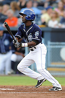 Asheville Tourists second baseman Juan Ciriaco #2 swings at a pitch during a game against the Augusta GreenJackets at McCormick Field on June 27, 2013 in Asheville, North Carolina. The Tourists won the game 10-6. (Tony Farlow/Four Seam Images)