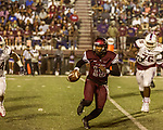 September 21, 2017. Durham, North Carolina.<br /> <br /> Nathaniel Tilque runs to avoid the South Carolina State defense.  <br /> <br /> The NCCU Eagles won a home game against the the South Carolina State Bulldogs 33-28 at O'Kelly–Riddick Stadium.