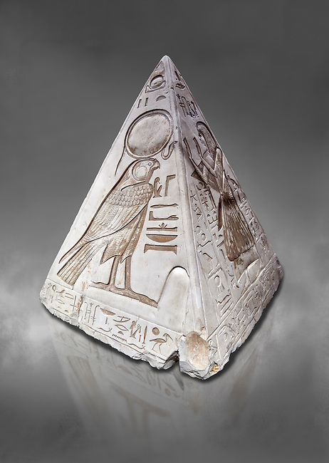 """Ancient Egyptian Pyramidion of Ramose North & East sides, Limestone, New Kingdom, 19th Dtnasty (1292-1190 BC), Dier el-Medina. Egyptian Museum, Turin. Old Fund cat 1603. Grey background.<br /> <br /> The north face of the Ramose Pyramidion explains the attribute of Horus as the strong coronal electric field of the Sun gifting the Ankh as a support to Life. It reads """"Strong coronal electric field supporting the Sun, negative charge induction."""""""" Weak electric field is an attribute of the anode Sun.""""""""Electricity supporting life to core charge store God"""".<br /> <br /> The east face of the Ramose Pyramidion shows the support for the structured plasma, her hands are held up representing the electric force on the perpendicular face to the North South axis of Horus, the strong coronal electric field. It reads"""" Structured plasma watched, attribute supporting life projecting power (negative charge) to support charge store (celestial body) electrostatic resonance."""""""" Seek home structured plasma to land negative charge projection by God as lightning attribute support celestial body via connection giving movement and [light].""""<br /> <br /> The limestone Pyramidion of Ramose, from the top of the tomb of the 'Necropolis Scribe'. Scenes on all four sides depict the worship of the sun."""
