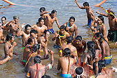 """Altamira, Brazil. """"Xingu Vivo Para Sempre"""" protest meeting about the proposed Belo Monte hydroeletric dam and other dams on the Xingu river and its tributaries. Kayapo Indian warriors bathe in the river."""