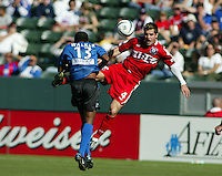 Chicago Fire's Carlos Bocanegra, right, collides with San Jose Earthquakes Jamil Walker, left, in the 2003 MLS Championship, in Carson, Calif.