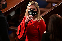"""United States Representative Marjorie Taylor Greene (Republican of Georgia) wears a """"Trump Won"""" face mask as she arrives on the floor of the House to take her oath of office as a newly elected member of the 117th House of Representatives in Washington, U.S., January 3, 2021.   <br /> Credit: Erin Scott / Pool via CNP /MediaPunch<br /> CAP/MPI/RS<br /> ©RS/MPI/Capital Pictures"""