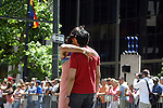 TWO MEN SHOW AFFECTIONS DURING GAY PRIDE PARADE