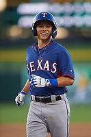 AZL Rangers Cody Freeman (33) smiles after hitting a single in the fifth inning during an Arizona League game against the AZL Athletics Gold on July 15, 2019 at Hohokam Stadium in Mesa, Arizona. The AZL Athletics Gold defeated the AZL Rangers 9-8 in 11 innings. (Zachary Lucy/Four Seam Images)