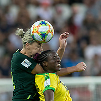 GRENOBLE, FRANCE - JUNE 18: Alanna Kennedy #14 of the Australian National Team, Tiffany Cameron #15 of the Jamaican National Team battle for head ball during a game between Jamaica and Australia at Stade des Alpes on June 18, 2019 in Grenoble, France.