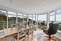 BNPS.co.uk (01202) 558833. <br /> Pic: ScottParry/BNPS<br /> <br /> Pictured: Dining room. <br /> <br /> Life's a beach...<br /> <br /> A coastal clifftop home above a picturesque Cornish beach is on the market for £1.75m.<br /> <br /> High Seas sits in a prime position above Millendreath Beach in Looe, the 'Cornish Riviera', with spectacular views across Whitsand Bay and out to sea.<br /> <br /> The impressive five-bedroom property has almost 5,000 sq ft of living space and a decent sized garden, but it's real draw is its location.<br /> <br /> The house is 150 yards from Millendreath Beach and its garden gate will take the owners straight onto the South West Coast Path.