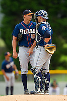 Durham Bulls catcher Chris Giminez (16) has a chat on the mound with starting pitcher J.D. Martin (30) during the International League game against the Charlotte Knights at Knights Stadium on August 18, 2013 in Fort Mill, South Carolina.  The Bulls defeated the Knights 8-5 in Game One of a double-header.  (Brian Westerholt/Four Seam Images)